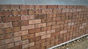 Brick adhered to the panel